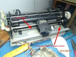 Panasonic dot matrix printer carriage showing the driver gear train and timing belt which convert rotary to linear motion