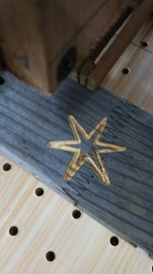 Engraved star on softwood work piece