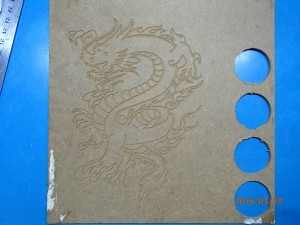 Finished dragon design engraved on soft board
