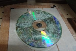 Engraved CD held in place by 3 masking tapes
