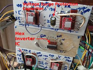 Voltage surge protection capacitor and Hex Inverter IC connected in place