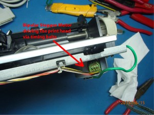 Bipolar stepper motor driving the print head via gears and timing belt