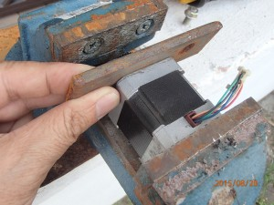 checking the spacing of the motor on the vise