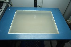 Tempered glass flushed over the table top